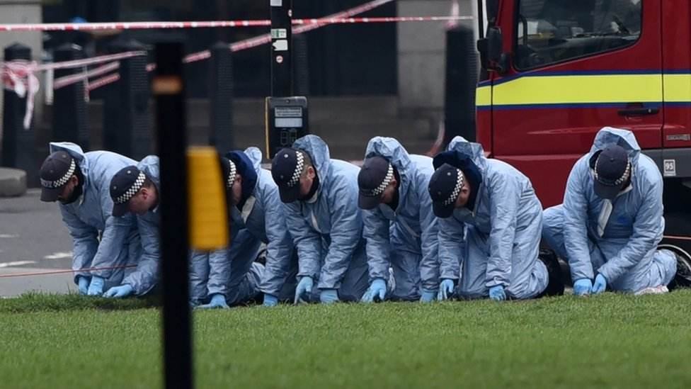 Police forensic officers work in Parliament Square
