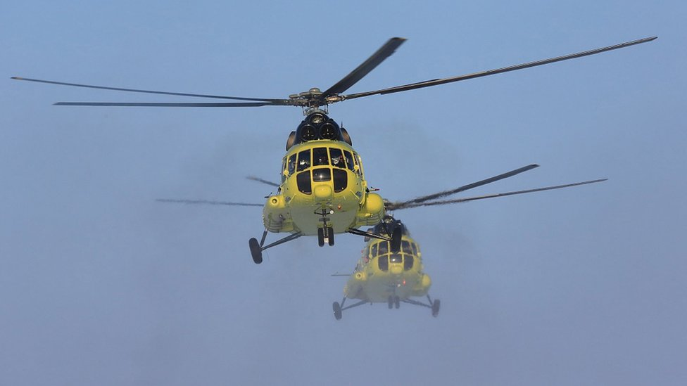 Handout photo showing two MI-8 helicopters belonging to Utair