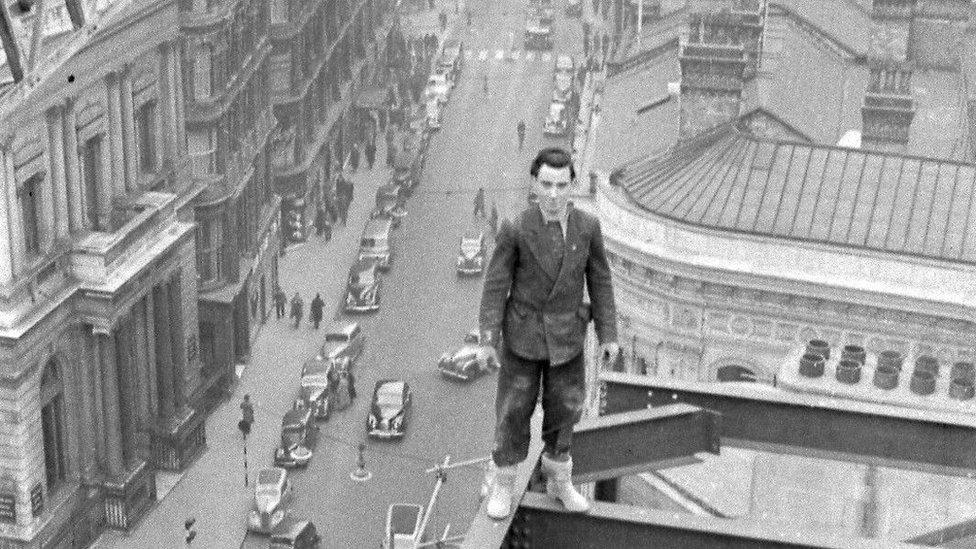 Man stands on scaffolding above Birmingham