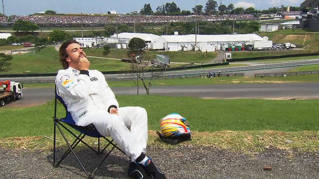 Fernando Alonso sunbathing at Interlagos