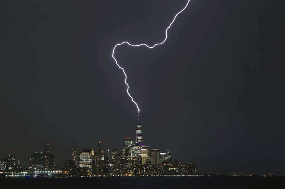 A lightning bolt strikes One World Trade Center in New York City.