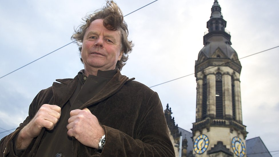 Siegbert Schefke, file pic, with Protestant church in background