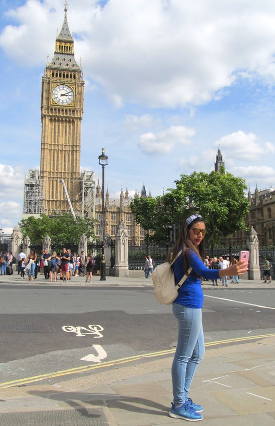 A woman taking a selfie in front of Big Ben