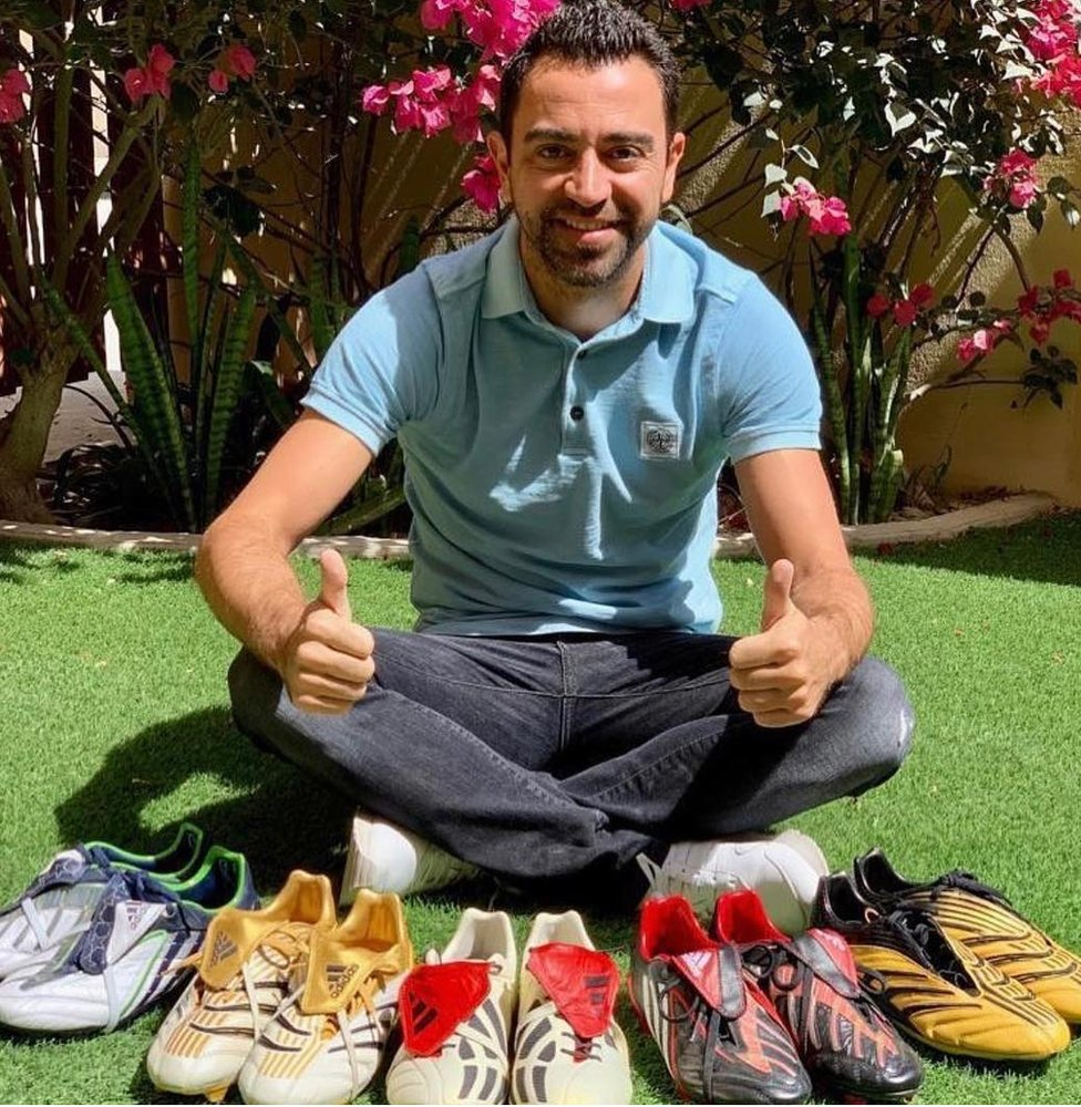 Xavi with five pairs of boots.