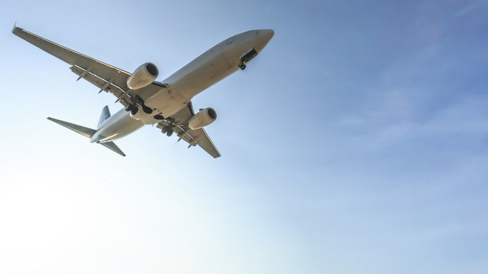 A commercial aeroplane flying in the sky