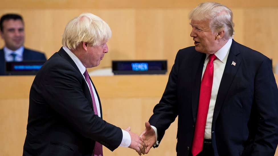 Boris Johnson (L) and US President Donald Trump greet before a meeting on United Nations Reform