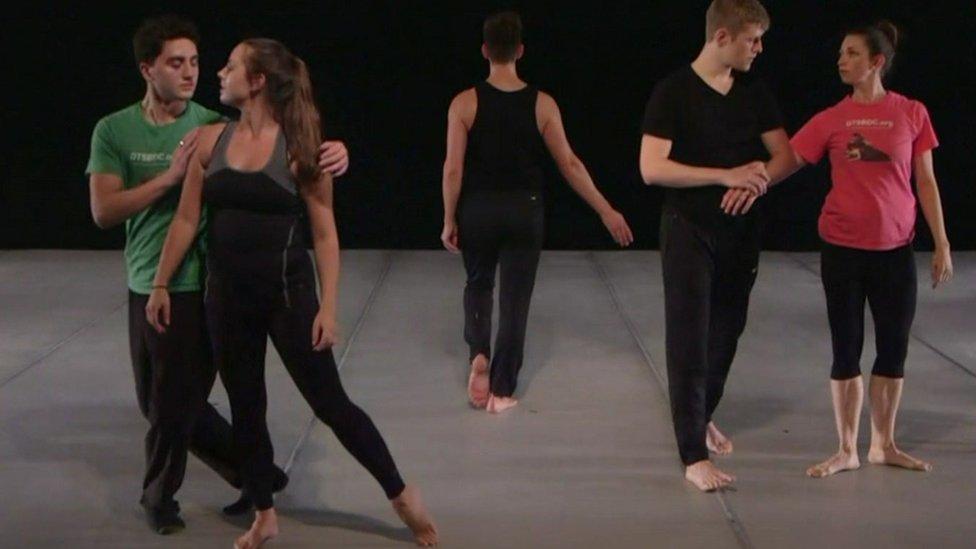 Dancers practising in a studio