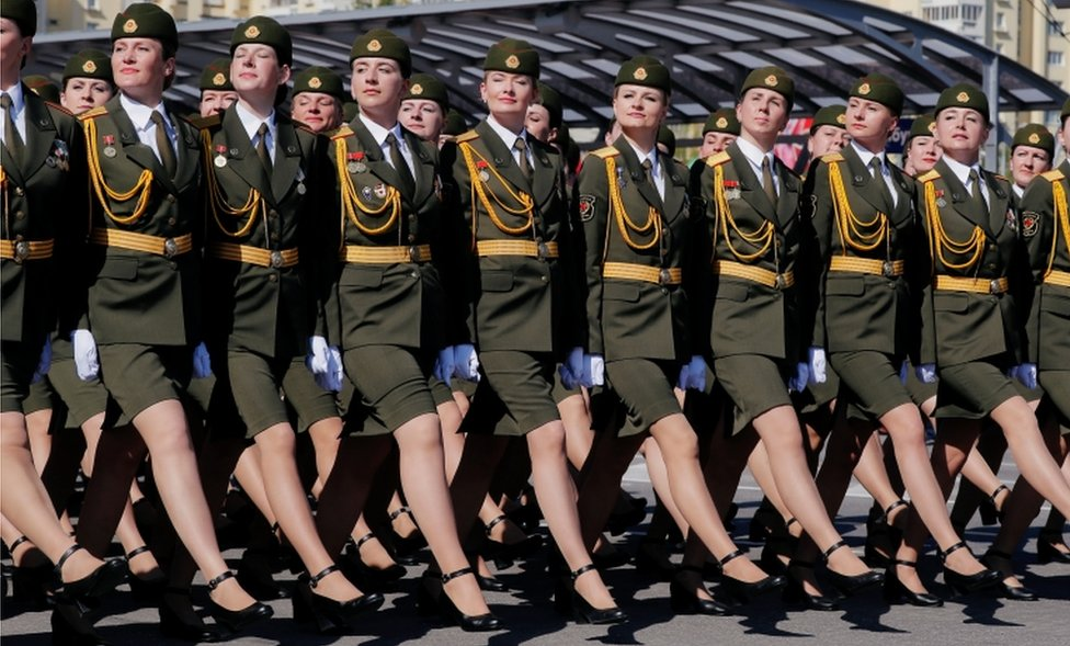 Belarusian soldiers take part in the Victory Day parade, which marks the anniversary of the victory over Nazi Germany in World War Two