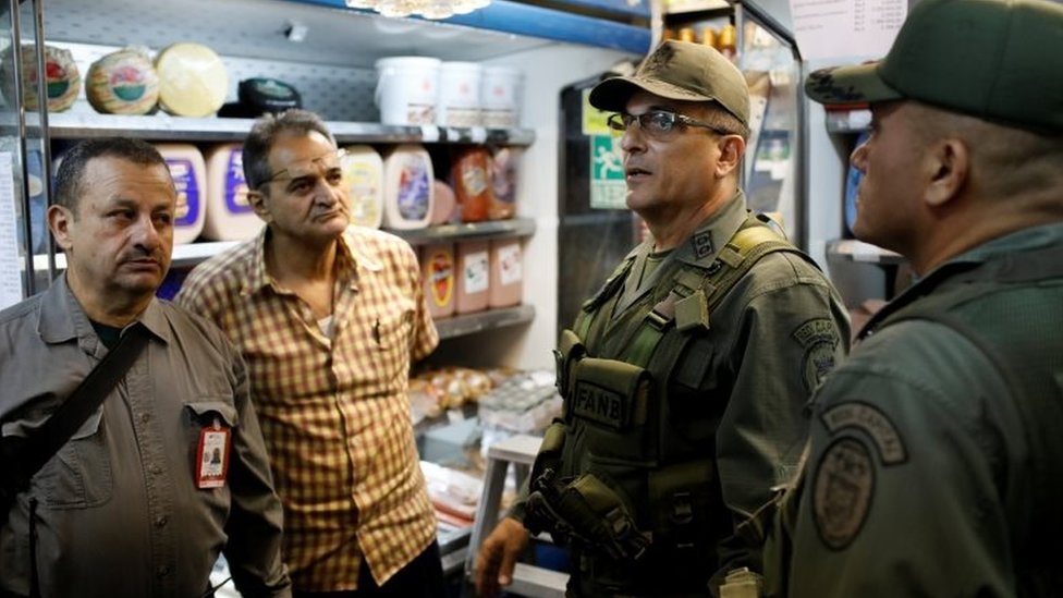 Vice-Admiral Victor Placencia (2nd R) takes part in a special inspection of Venezuelan soldiers to a municipal market in Caracas, Venezuela June 20, 2018