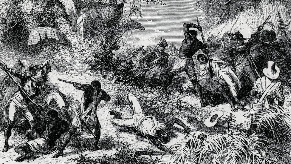 Enfrentamiento entre esclavos haitianos y tropas francesas.