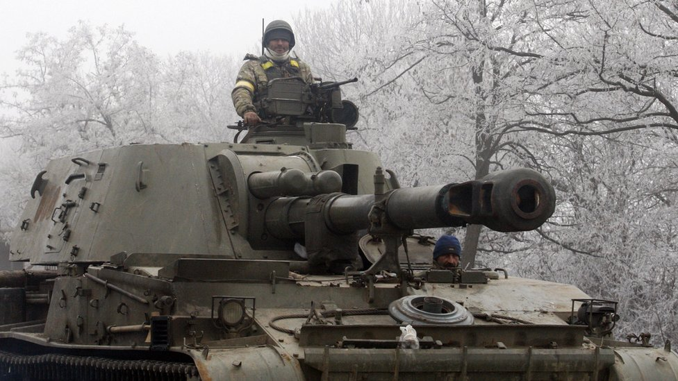A Ukrainian soldiers sits atop a self-propelled howitzer. File photo
