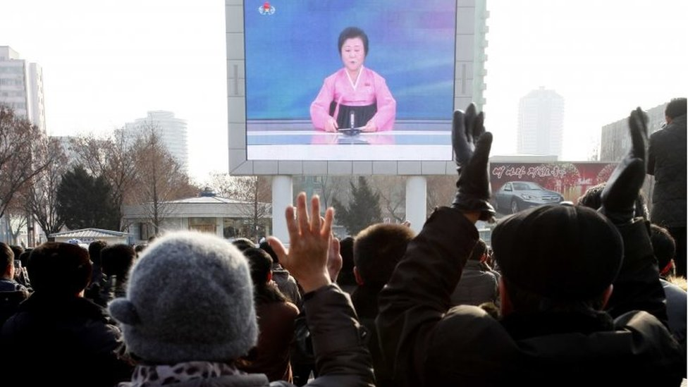 North Koreans watch a news broadcast on a video screen outside Pyongyang Railway Station in Pyongyang, North Korea, Wednesday, Jan. 6, 2016.