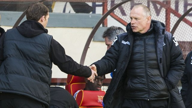 Alan Archibald (left) and John Hughes shake hands after the match