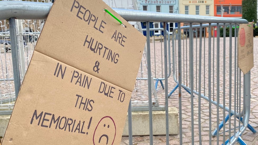 Abuse memorial protest placard