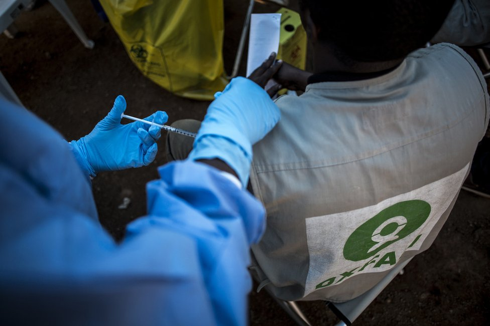 A medical practitioner administers the Ebola vaccine to an Oxfam worker on 17 August in Mangina