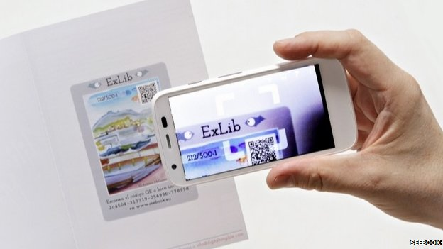 Smartphone scanning e-book QR code