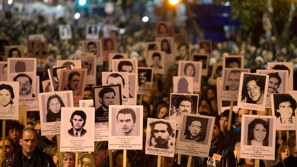 People take part in the 22th March of Silence in memory of people who went missing during the military dictatorship (1973-1985), in Montevideo on May 20, 2017