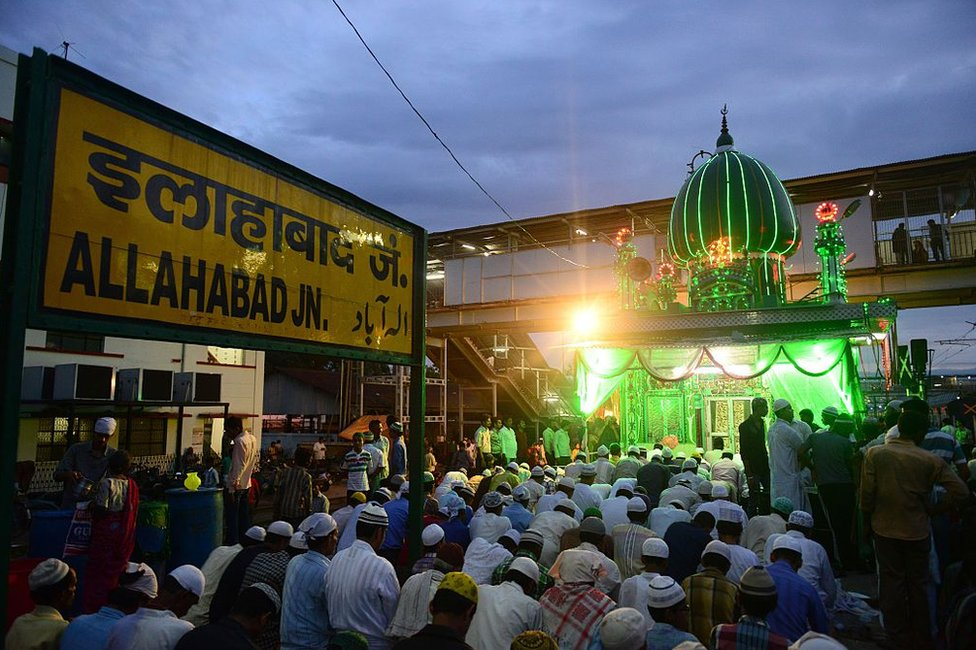 Indian Muslim devotees offer prayers after breaking their fast outside the Line Shah Baba Mosque in Allahabad.