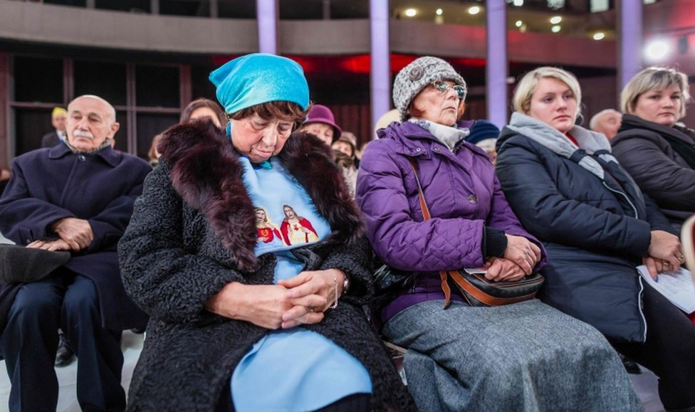 People attend in the inauguration holy mass in the Temple of Divine Providence, in Warsaw, Poland, on November 11, 2016.