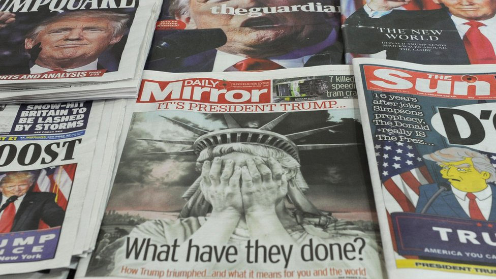 Newspapers after the US election, displayed for a camera