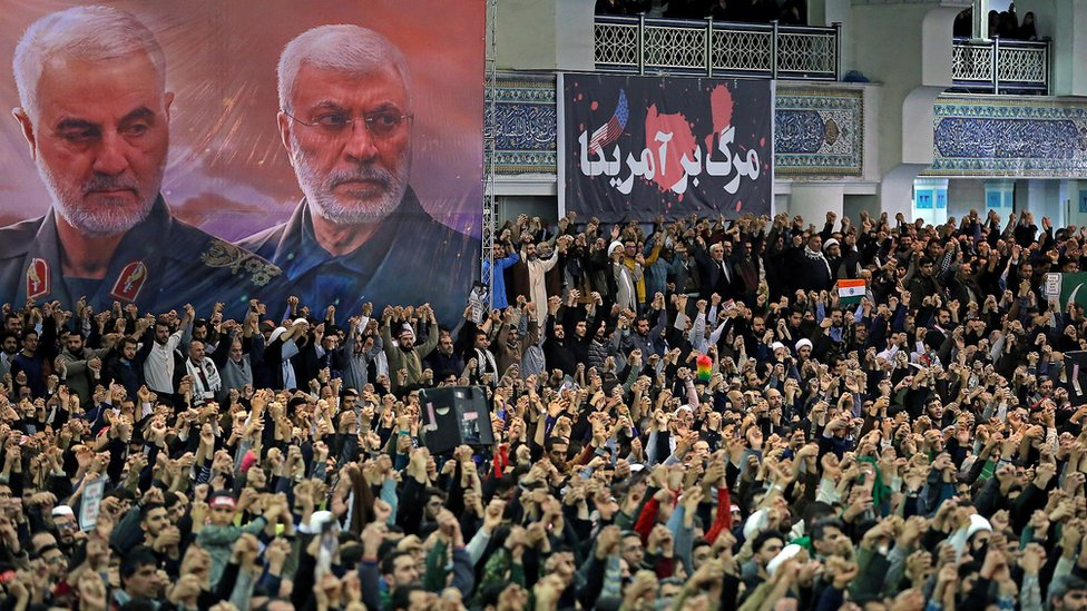 Image shows Iranians gathered for Friday prayers in the capital Tehran, under portraits of Qasem Soleiman