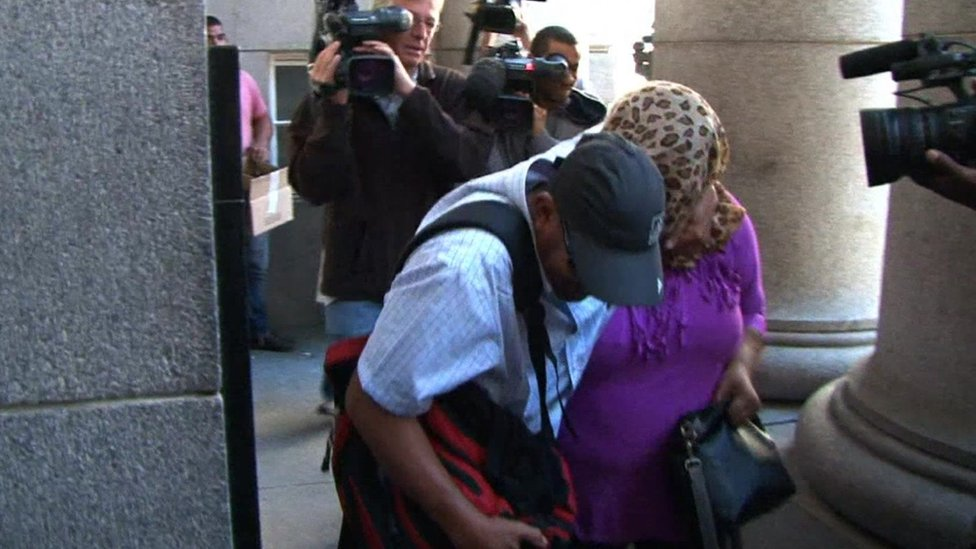 The accused arriving in court