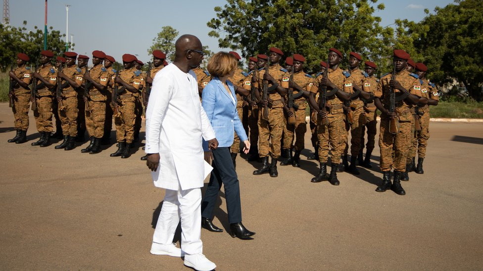 "Cherif Sy, Burkina Faso""s Defense Minister (L) and Florence Parly, France""s Defense Minister review the troops during a visit at the Burkinabe minister of Defense in Ouagadougou"