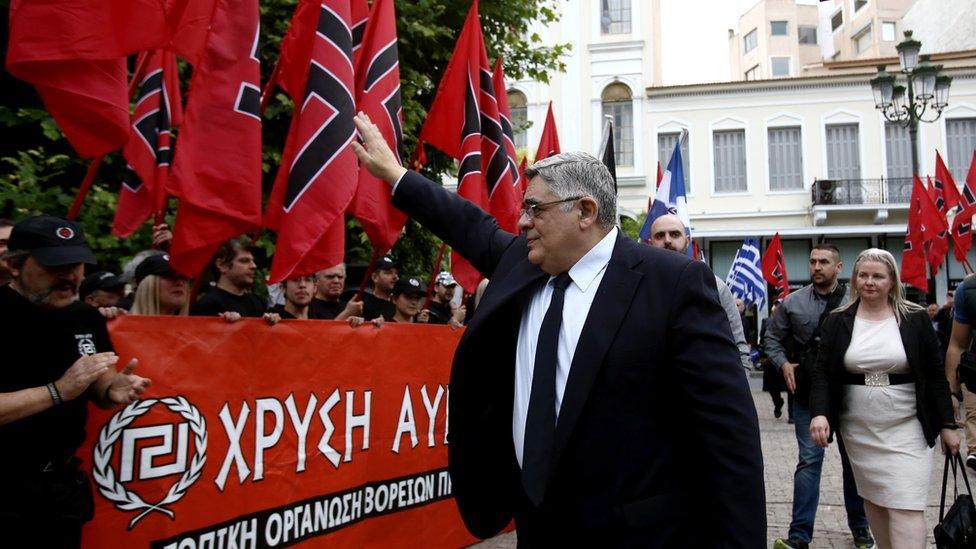 Golden Dawn leader Nikolaos Michaloliakos salutes party supporters in 2017 (file pic)