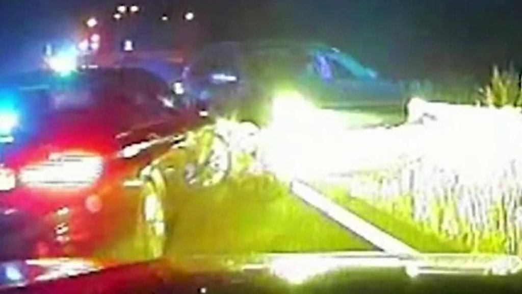 Moment car drove into police officer