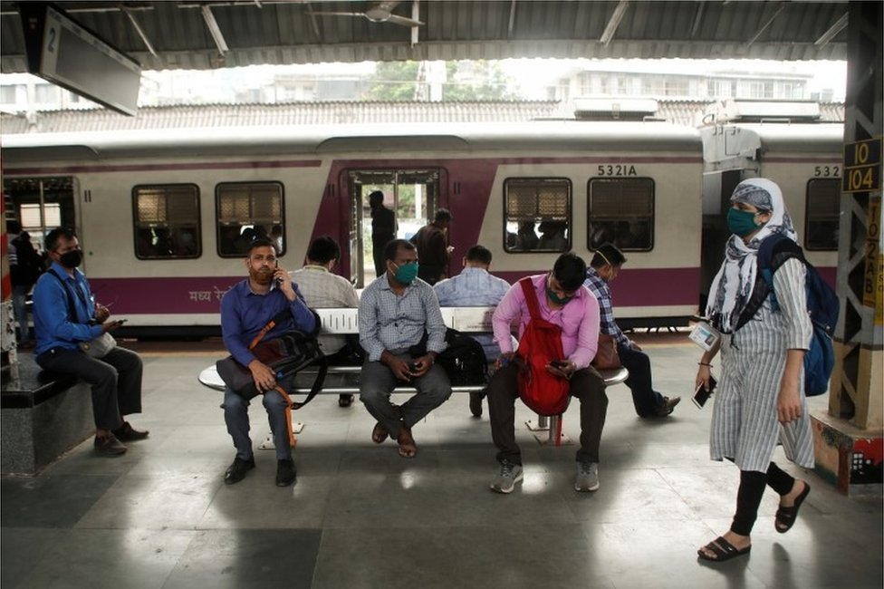 Commuters wait on a railway platform after trains were stalled during a power outage in Mumbai, India, October 12, 2020.