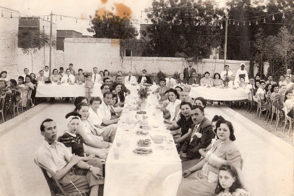 People sitting at a festival table