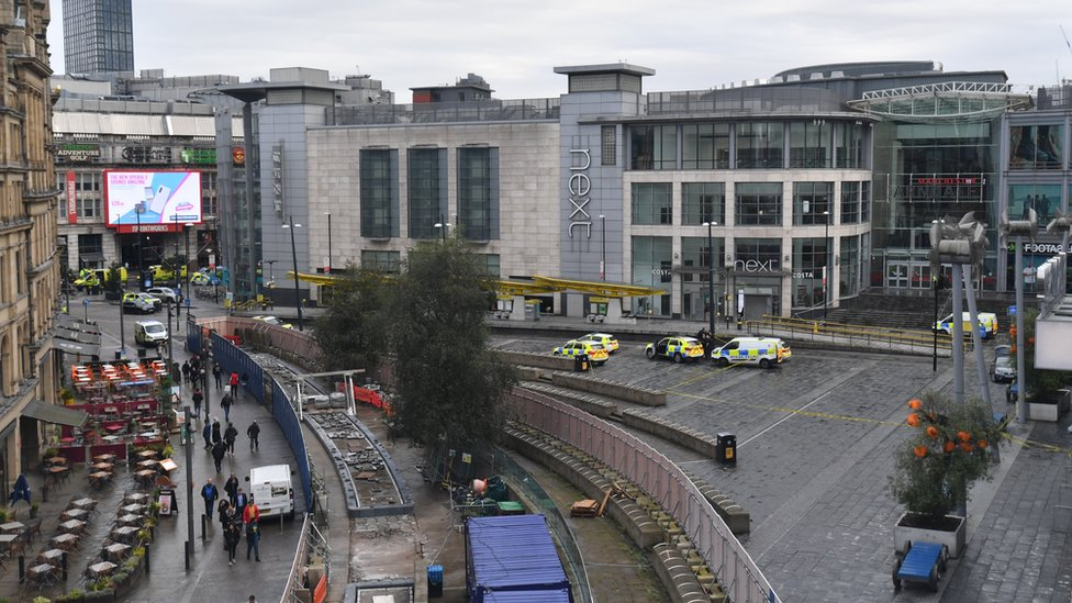 View of the Arndale Centre with police cars from a distance