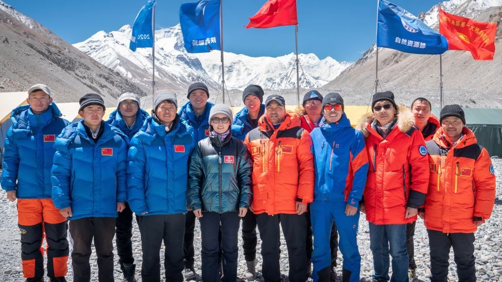 Members of Chinese surveying team pose for photos at Everest Base Camp on May 10, 2020 in Shigatse, Tibet Autonomous Region of China. Image credit - Getty Images
