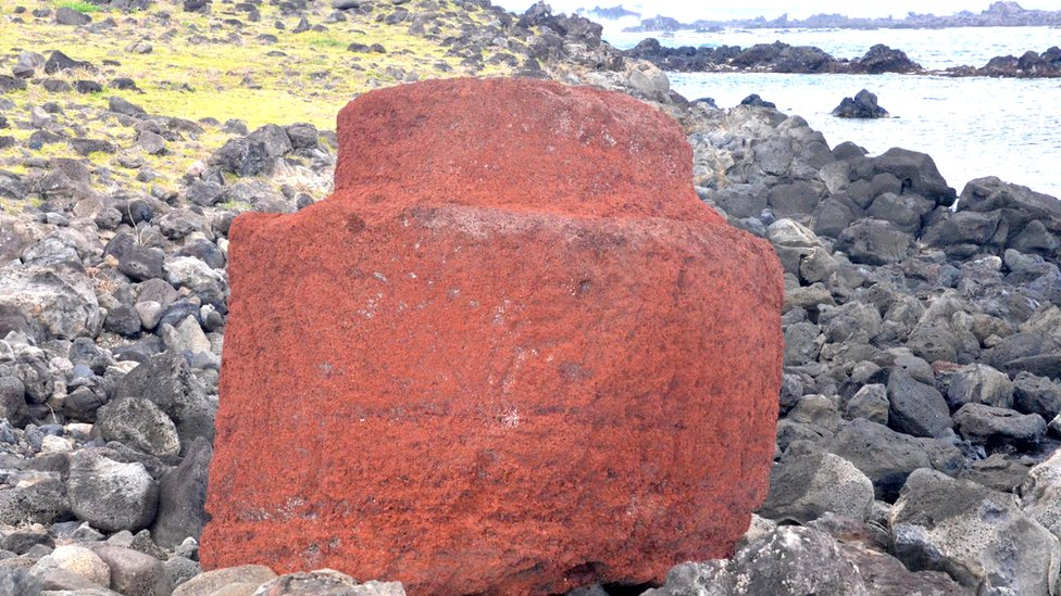 Red scoria pukoa hat with smaller cylindrical projection on top