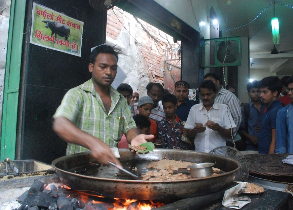 An Indian vendor makes kebabs made from beef at the Tundey Kebabi restaurant in Lucknow on May 17, 2017