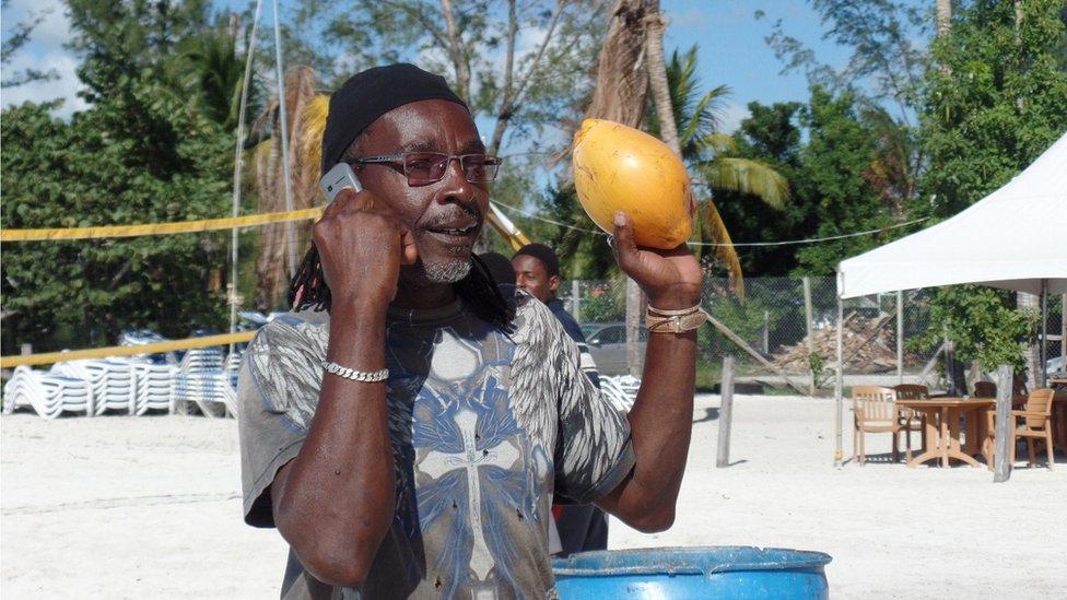 Coconut stall holder in Antigua - December 2015