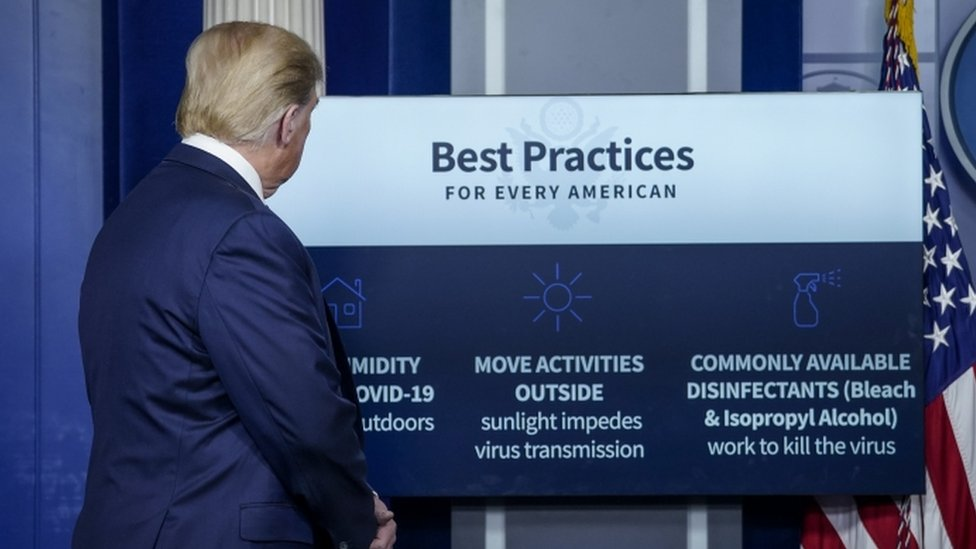 Donald Trump with a list of possible Covid-19 treatments at the White House briefing, 23 April 2020