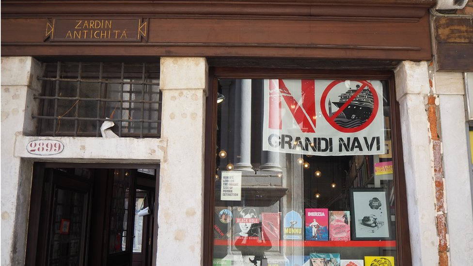 A book shop in Venice displaying the 'No Big Ships' flag