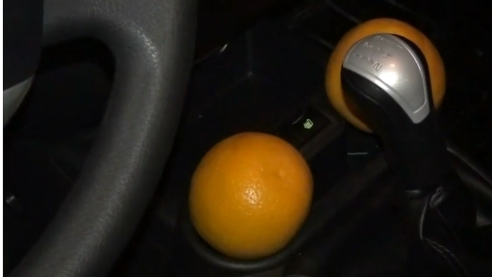 Oranges inside robbery suspect's car