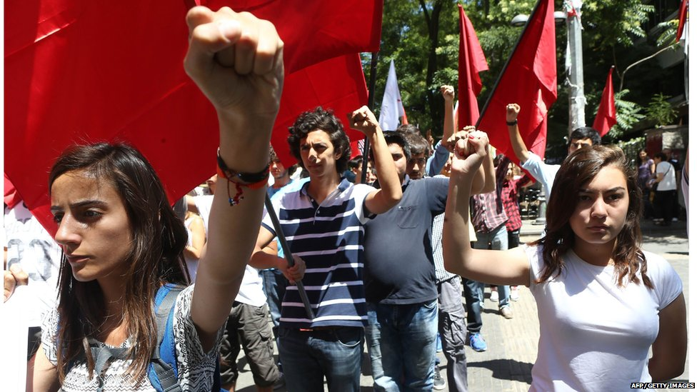 High school students chant slogans denouncing a suicide bombing in the Turkish border town of Suruc that killed 32 activists, during a demonstration in Ankara on July 23, 2015