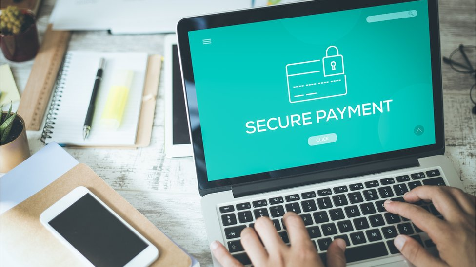 A laptop screen showing secure payments