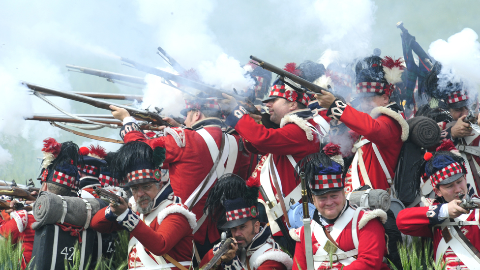 Men dressed as Scottish soldiers fight in a reeanactment of the battle of Waterloo on June 21, 2009 with some 1,200 others history enthusiasts from 20 European countries.