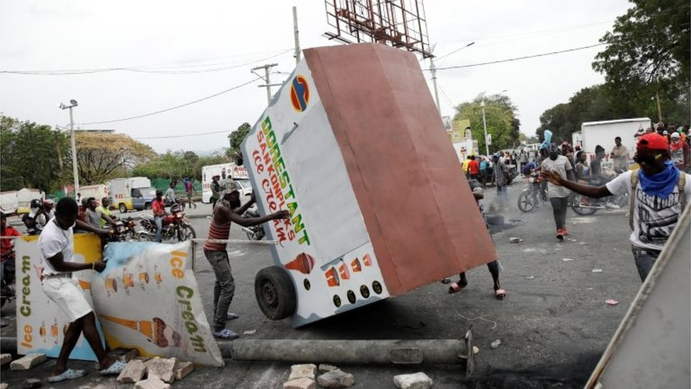 Demonstrators build barricades during a protest in Port-au-Prince, Haiti February 24, 2020.