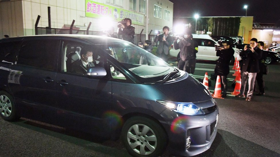 In this Sunday, March 27, 2016 photo, a police car carrying a girl who had been abducted, leaves the police headquarters in Niiza, Saitama prefecture, near Tokyo