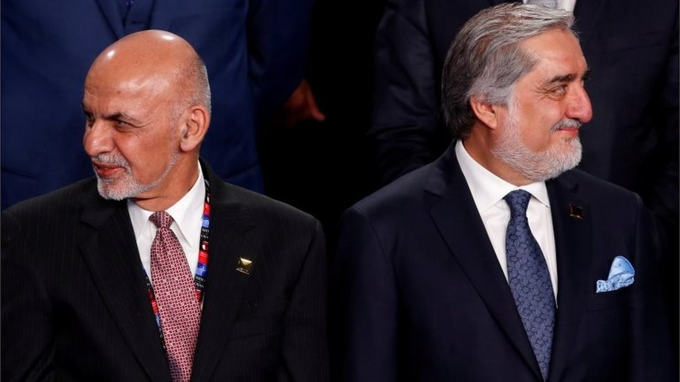 Ghani and Abdullah participate in a family photo with Ghani and Abdullah at the NATO Summit in Warsaw, Poland