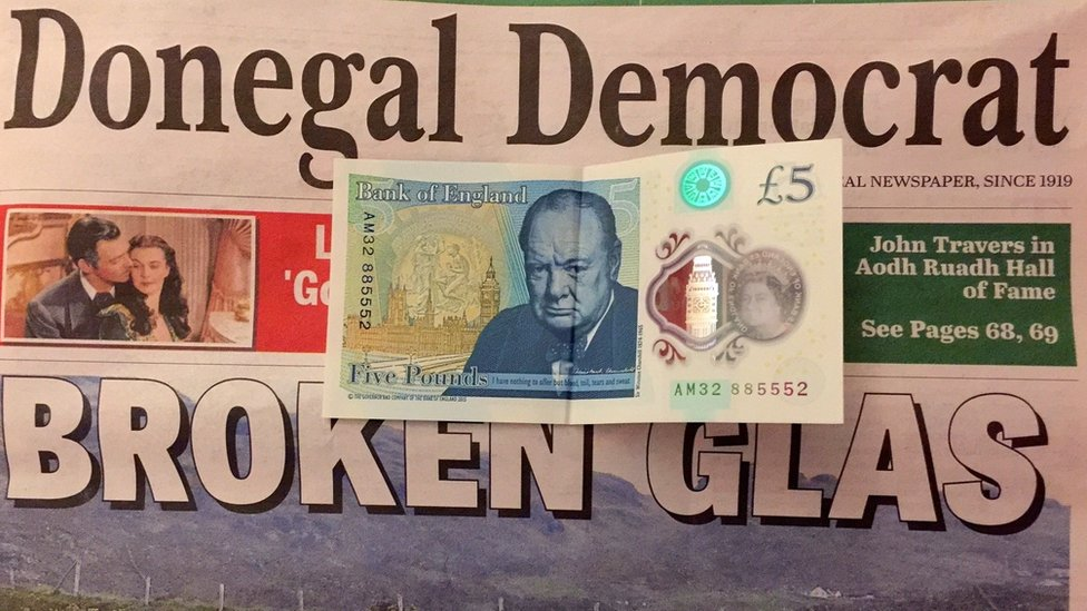 Five pound note with Donegal Democrat