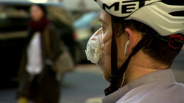 Man in cyclist helmet and face mask