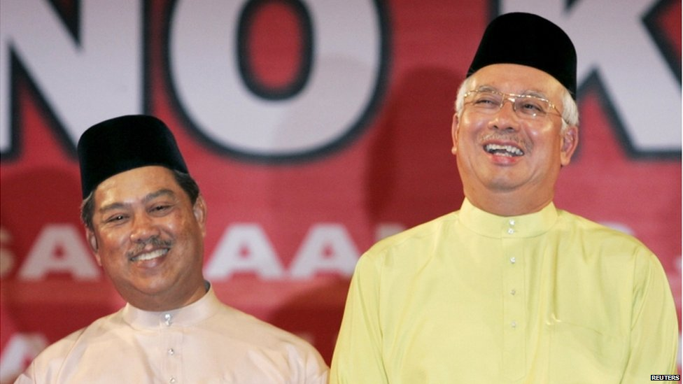 Malaysia' Prime Minister Najib Razak (R) and his deputy Muhyiddin Yassin share a light moment during the 63rd anniversary of the United Malays National Organization (UMNO) in Kuala Lumpur in this 11 May 2009 file photo