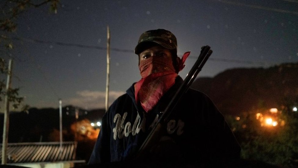 A community police agent, poses for a photo as he guards a check point in Ayahualtempa, Mexico, January 30, 2020.