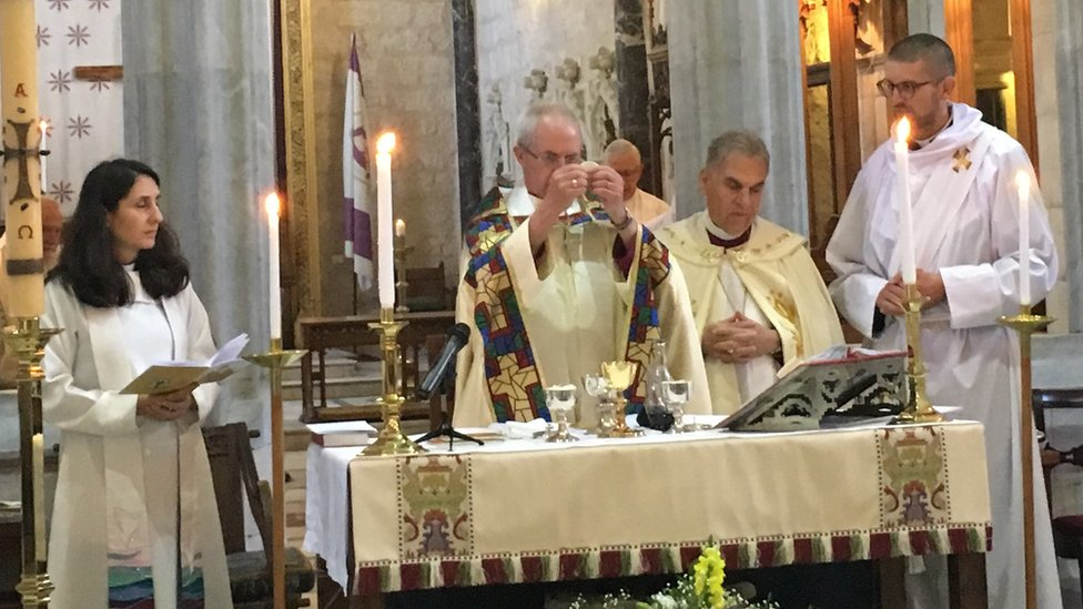 Justin Welby presides over holy communion at St George's Cathedral in Jerusalem
